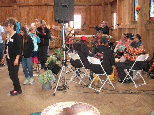 Drummers and singers provide pie walk music